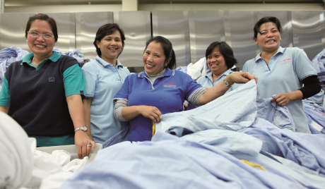 A group of Linen Services staff sorting laundry