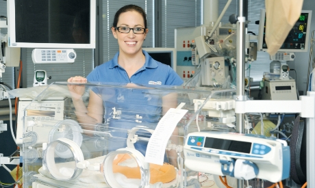 A neonatal intensive care nurse with humidicrib